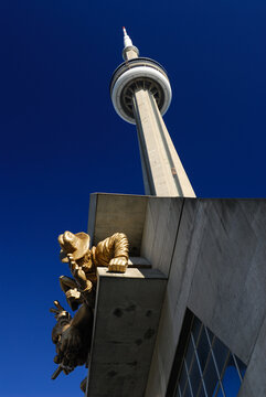 Toronto, Canada - October 6, 2006: Rogers centre spectator sculpture and CN tower against a blue sky