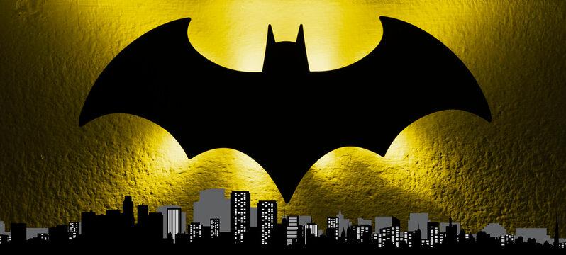 Bologna / Italy - September 18, 2019: The batsignal light from the Gotham cityscape to celebrate the Batman's 80th birthday. Batman day concept.