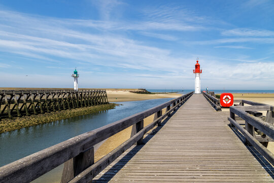 Red and green lighthouses and wooden piers in Trouville, resort in Normandy, France.