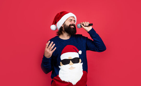 present and gift shopping sale. happy new year. merry christmas. cheerful bearded man in santa claus hat and sweater. brutal hipster celebrate xmas party. winter holiday preparations