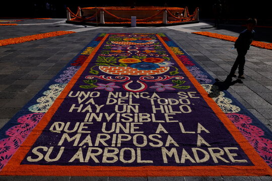The main square of Mexico's Presidential Palace is decorated with cempasuchil or marigolds flowers to commemorate Day of The Dead in memory of the victims of the coronavirus disease (COVID-19)