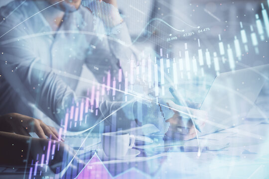 Double exposure of man and woman working together and financial graph hologram. Business concept. Computer background.