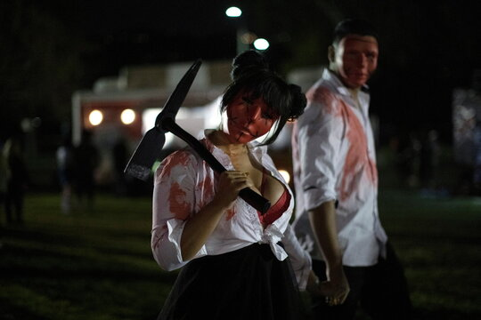 People wearing costumes attend  Joe Bob's Haunted Drive-In Halloween experience at Rose Bowl during the outbreak of the coronavirus disease (COVID-19), in Pasadena