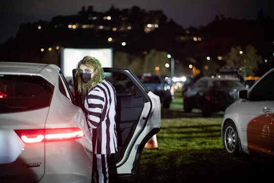 A person dressed like the character of Beetlejuice attends  Joe Bob's Haunted Drive-In Halloween experience at Rose Bowl during the outbreak of the coronavirus disease (COVID-19), in Pasadena