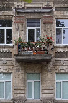 The facade with flowers on the balcony.