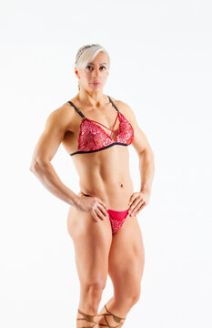 very muscular handsome athletic woman on white background