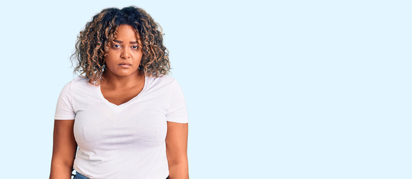 Young african american plus size woman wearing casual clothes depressed and worry for distress, crying angry and afraid. sad expression.