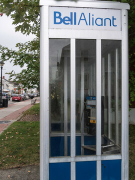 ST ANDREWS, NEW BRUNSWICK CANADA - CIRCA SEPTEMBER 2016 - A phone booth is still available here on a street in St Andrews.