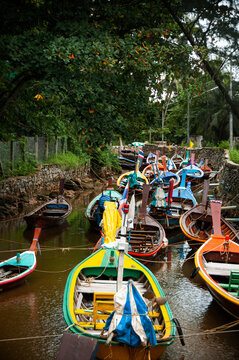 Thailand longtail fishing boat in small canal