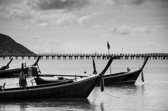 Thailand longtail fishing boat at Chalong bay. Phuket. Black and white