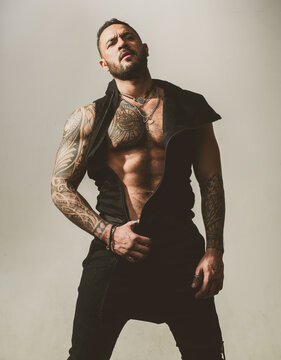 Muscular sexy man with a naked torso.