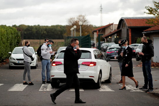 Police officers conduct a control to verify the identity of teachers at the entrance of the Bois d'Aulne college in the Paris suburb of Conflans-Sainte-Honorine