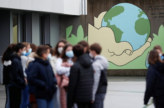 A teacher and schoolchildren pay tribute to French teacher Samuel Paty in France