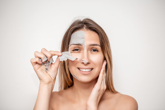 Facial Mask. Woman Applying Cosmetic Alginate Mask, chitosan, allantoin, marine collagen for detoxifying the skin and for black heads and acne