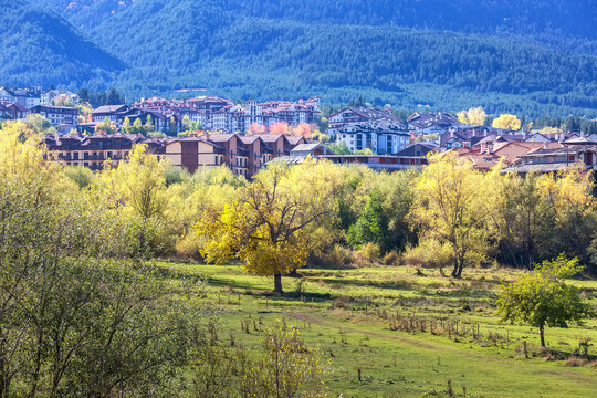Bansko, Bulgaria town panorama with houses and colorful autumn trees