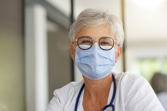 Portrait of woman doctor wearing face mask during covid-19 pandemic