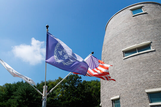 US and UN flag in front ot JSA Visitor Center in the border zone DMZ between North and South Korea