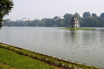 Hoan Kiem Lake also know as Sword Lake with Turtle Tower. Green grass and trees in public park in historical center in Hanoi, Vietnam Wall mural