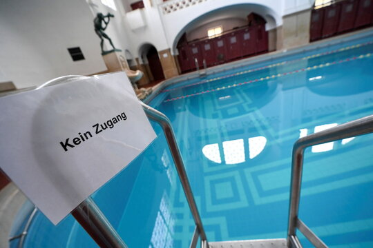 """A sign reading """"no entry"""" is seen inside Mueller'sches Volksbad on the first day of the temporary closing of restaurants and sporting facilities, as the spread of the coronavirus disease (COVID-19) continues in Munich"""