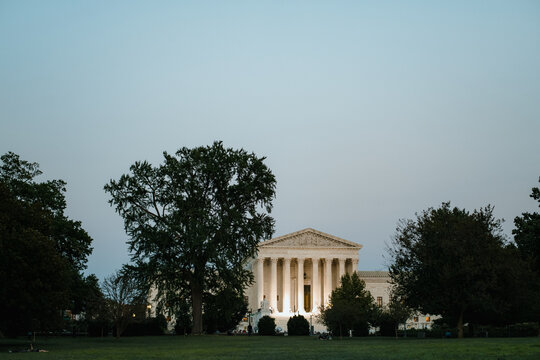 Supreme Court of the United States building at dusk with illumination