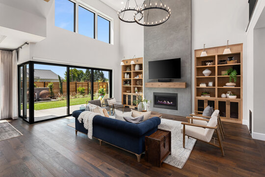 Living room in new luxury home with floor to ceiling fireplace