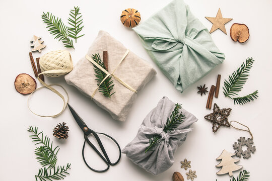 Fabric wrapped gifts and wooden Christmas decorations