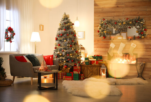 Beautiful Christmas tree in living room, bokeh effect. Festive interior