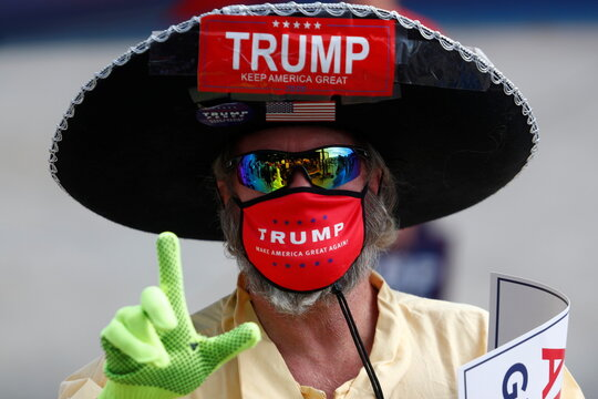 A supporter gestures as he takes part in a campaign rally from Donald Trump Jr for U.S. President Donald Trump ahead of Election Day in Scottsdale, Arizona