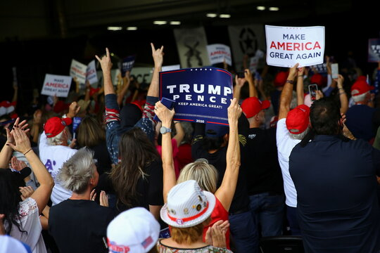 Supporters attend to take part in a campaign rally from Donald Trump Jr for U.S. President Donald Trump ahead of Election Day in Scottsdale, Arizona