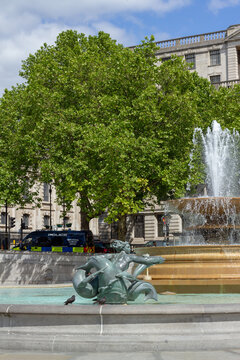 London, UK, 2020: Trafalgar Square is empty except for a police van