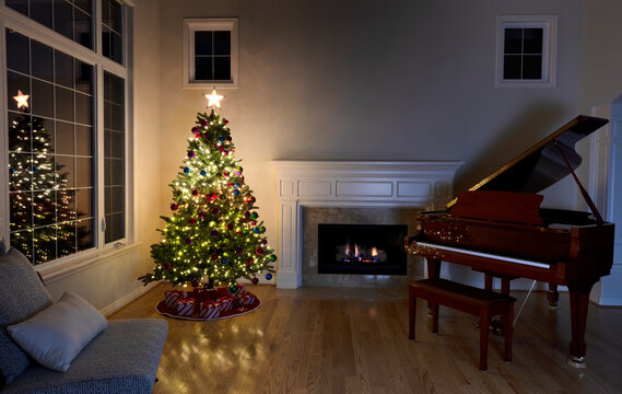 Lighten Christmas tree and glowing fireplace during night time in family living room