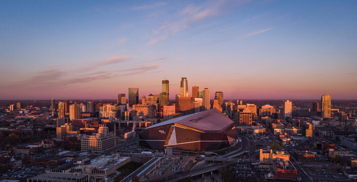 Drone flight over the skyline of Minneapolis, Minnesota USA with a nice view to the US Banks Stadium from the Vikings