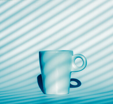 coffee cup on blue and white background