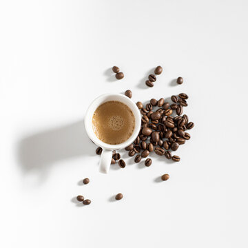 full coffee cup on white background with beans