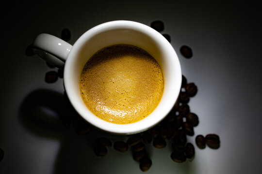 full coffee cup on dark background