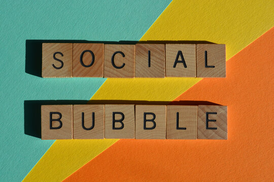 Social Bubble, words in wooden alphabet letters isolated on colourful background