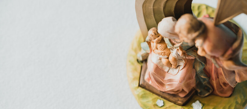 Christmas nativity scene of born child baby Jesus Christ in the manger with Joseph and Mary.Traditional Christmas Nativity Scene banner background of baby Jesus in the Christmas with Mary and Joseph.