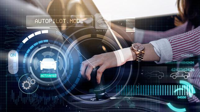 Auto pilot self driving car businesswoman gear handle mode switch, HUD Head Up Display and digital instruments panel autonomous user interface navigation utility screen smart technology hologram