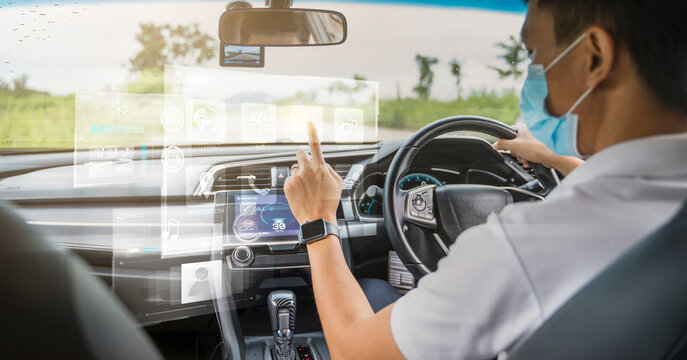 HUD Head Up Display and digital instruments panel autonomous car dashboard user interface navigation driving utility wearing surgical facemask finger touching graphical screen smart technology control