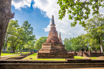Landmark of old chedi made of ancient bricks in the Kamphaeng Phet Historical Park, Thailand.