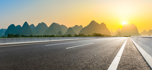 Country asphalt road and green mountain natural scenery in Guilin at sunrise,China. Fotomurales