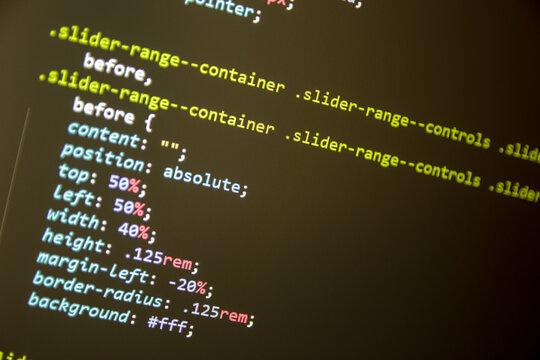 Wordpress theme code close up. Laptop screen with CSS code