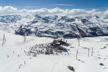 Apres ski in Les Menuires resort in winter. French alps in winter, snowy mountains in France