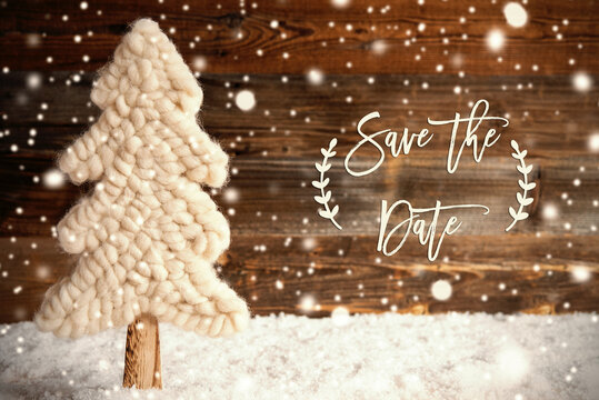 English Calligraphy Save The Date. White Fabric Christmas Tree With Snow. Brown Rustic Wooden Background With Snowflakes