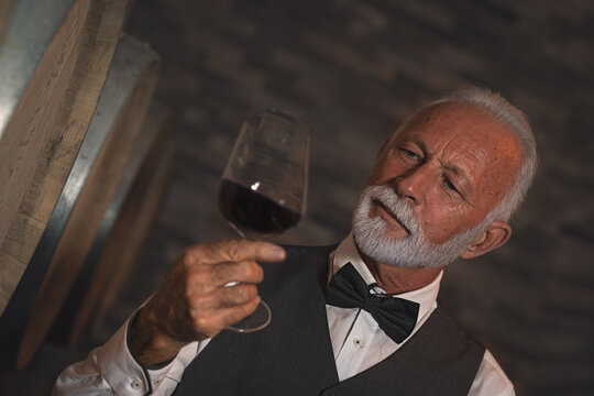 Professional sommelier looking at the color of the wine