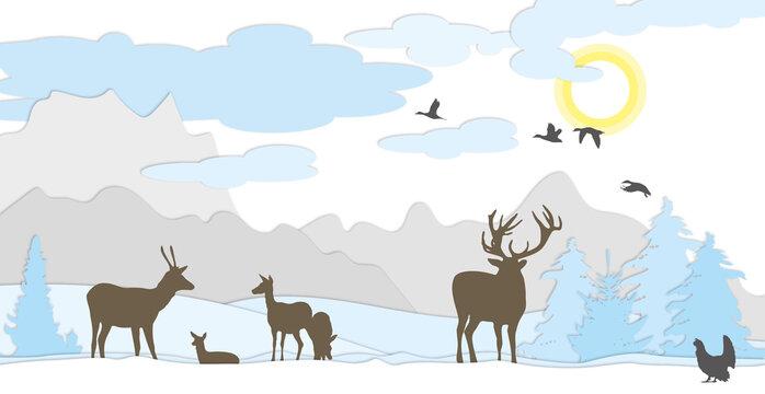 Hirsche auf Wiese Winter