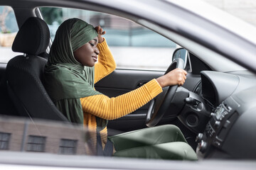 Tired African Muslim Lady Driving Car, Having Headache And Feeling Sleepy