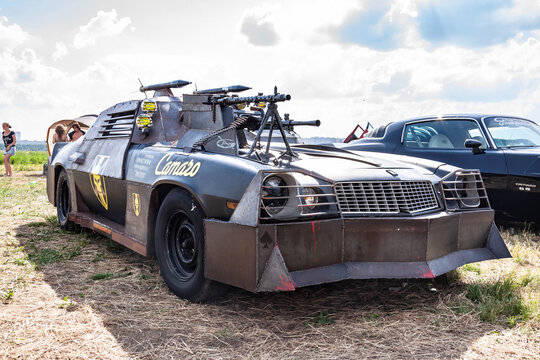 Moscow, Russia - May 25, 2019: Chevrolet Camaro tuned and remade for survival with a zombie apocalypse. Armored with a mounted machine gun. Parked in the field. Left front side