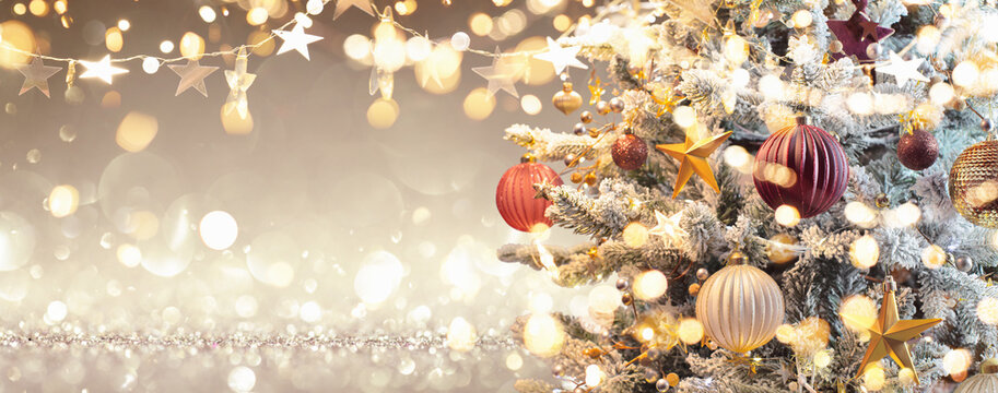 Christmas Tree with Decorations and Glitter. Gold Background