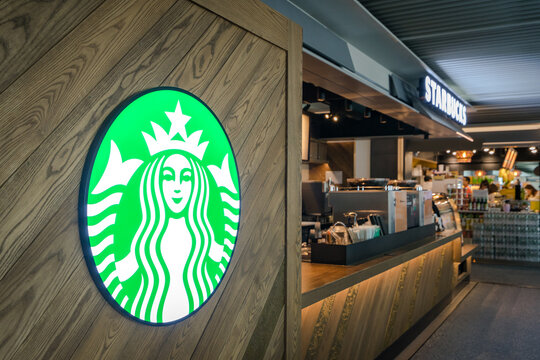 Donmuang airport, Bangkok / Thailand - July 2019 : Starbucks coffee branch at Donmuang airport is opening 24 hours to service for airport passenger. Selected focus on trademark logo.